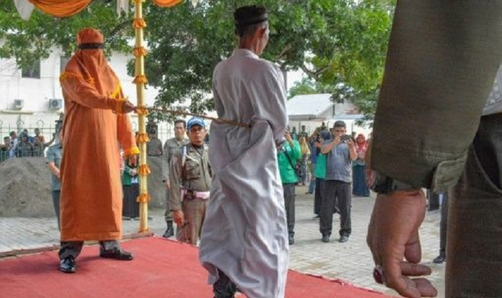 Indonesia's Aceh whips men for sharia-banned gambling