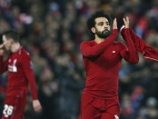 Salah sends Liverpool into last 16, Moura rescues Spurs