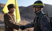 North and South Korea soldiers cross DMZ in peace