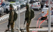 Israeli troops arrest dozens in West Bank