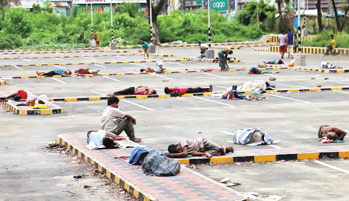 Day labourers sleep on the car parking ground