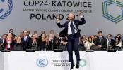 Climate talks deliver 'rule book'