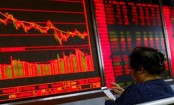 Asian markets slump after Fed hikes rates