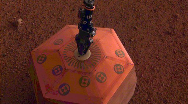 NASA's InSight lander places first Instrument on Mars