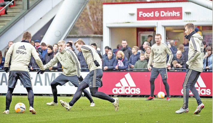 Matthijs de Ligt, second left, vies for the ball during an open training of Ajax Amsterdam prior