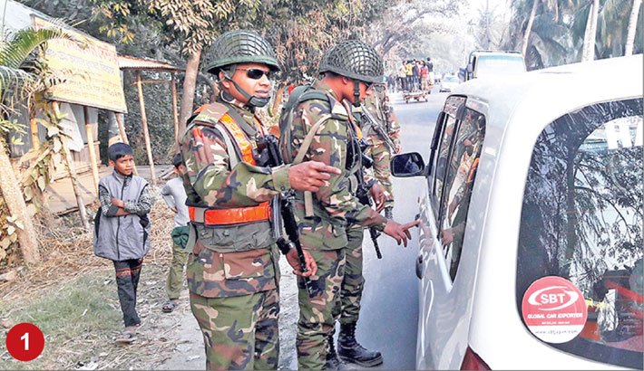 Members of Bangladesh Army search vehicles