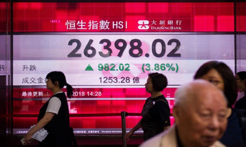 Hong Kong ends tough year with gains after Trump hails trade progress