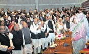 Awami League President Sheikh Hasina waves to new lawmakers following