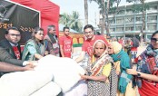 Five Japanese companies distribute blankets among poor