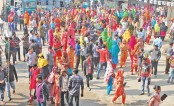 Garment workers stage a demonstration by blocking