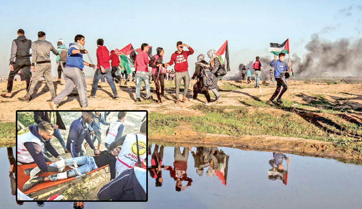 Palestinians run during clashes following a demonstration