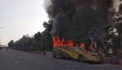 Garment workers set a bus on fire at airport road in capital