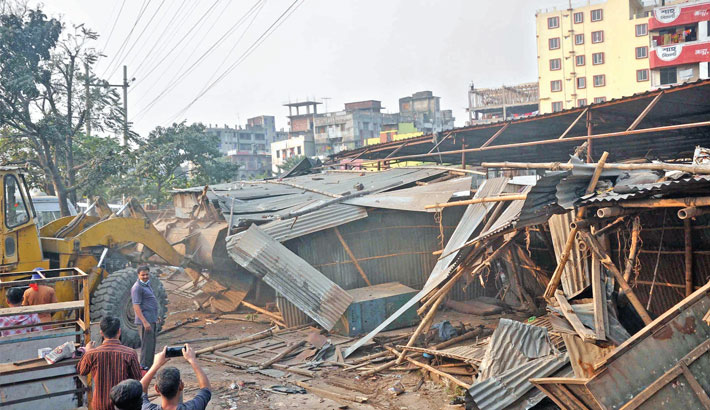 The Roads and Highways Department authorities demolish unauthorised structures during a drive