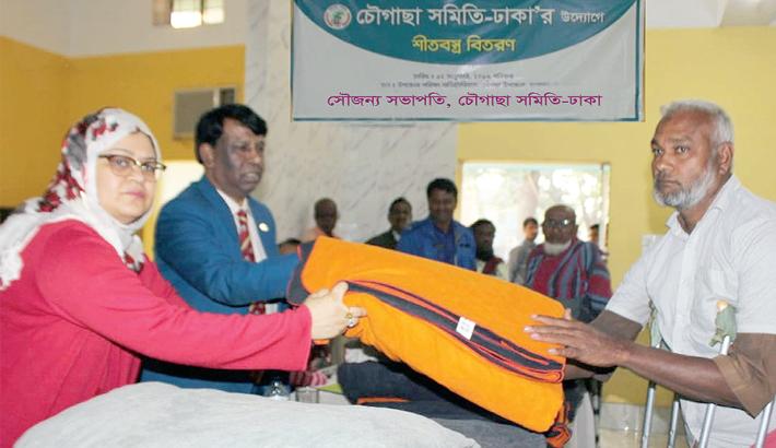 Chougachha Association-Dhaka distributes blankets