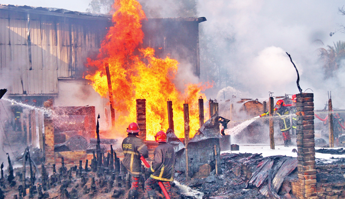 Oil depot,  houses gutted  by fire in Ctg