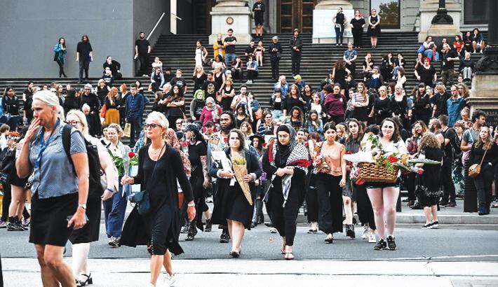 People attend a vigil in memory of murdered Israeli student Aiia Maasarwe