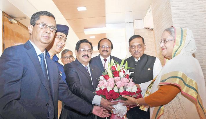 Home Minister Asaduzzaman Khan Kamal greets Prime Minister Sheikh Hasina