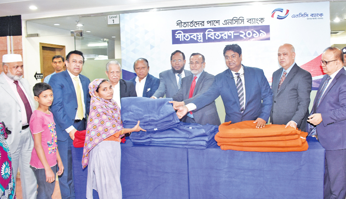 NCC Bank gives  blankets to cold-hit people