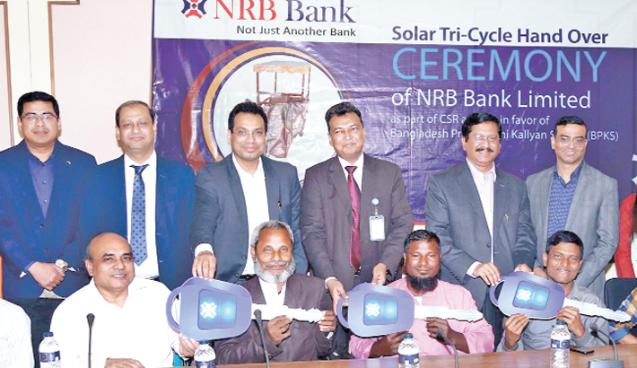 NRB Bank gives  tricycles to physically-challenged people