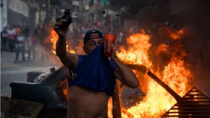 'Four dead' in Venezuela as thousands rally against Maduro