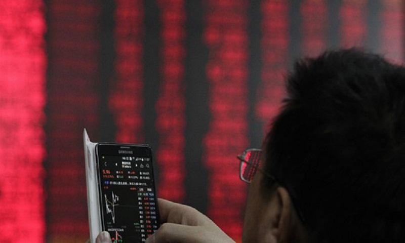 Asian markets mixed as investors track trade talks, shutdown