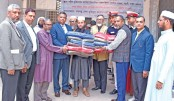 BSMRMU Vice Chancellor Rear Admiral M Khaled Iqbal hands out winter clothes and blankets among 500 students