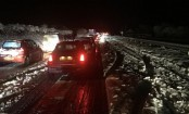 UK weather: Heavy snowfall sweeps eastwards causing disruption