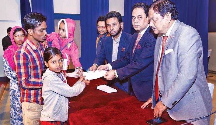 BGMEA President Md Siddiqur Rahman hands over cheques