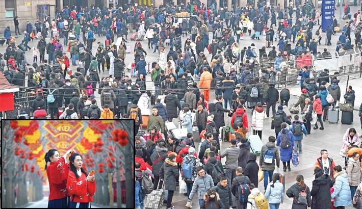 Passengers walk outside Beijing Railway Station