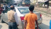 A private car narrowly escapes an accident in Moghbazar Wireless Rail Gate area
