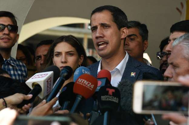 Venezuela's Guaido warns military on blocked aid