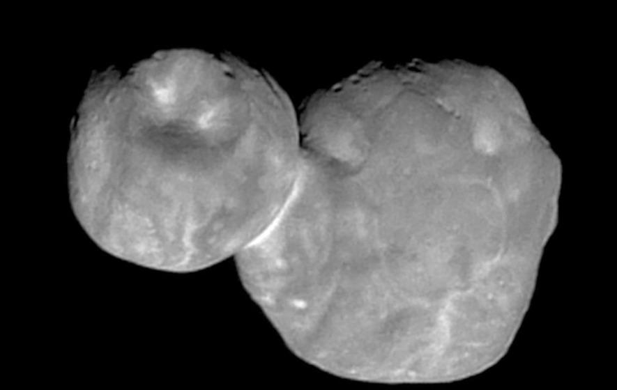 NASA's faraway space snowman has flat, not round, behind