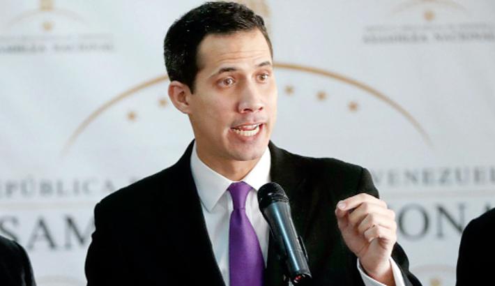 Guaido warns military on blocked aid