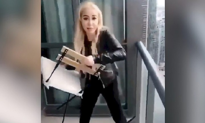 Police ask woman who threw chair from balcony to surrender
