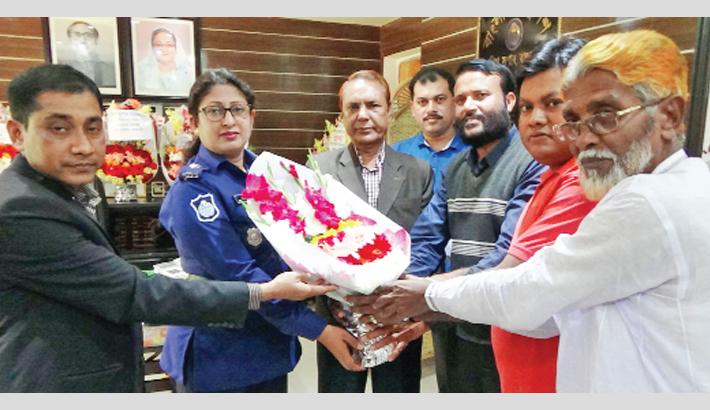 Members of community policing forum greet Superintendent of Police of Rajbari