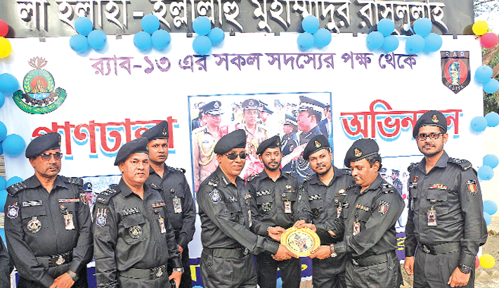 Winning Bangladesh Police Medal in a ceremony