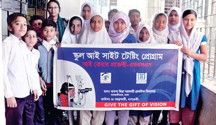 Students of Badsha Mia Government Primary School hold a banner prior