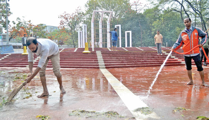 Workers clean up the Shaheed Minar premises on Sunday