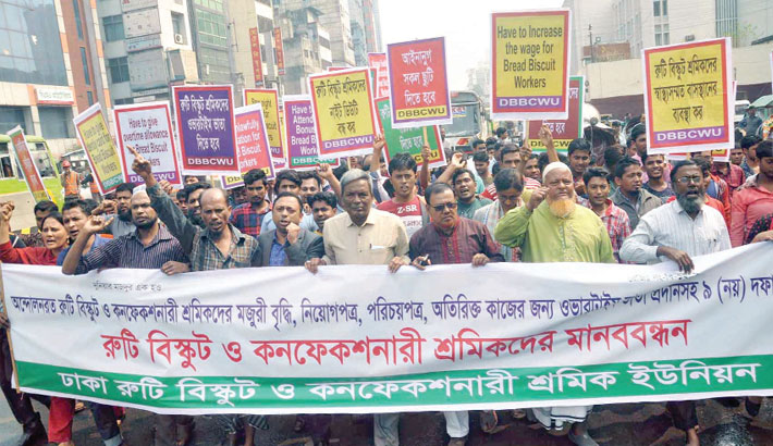 Workers in confectionery and bakery sector take out a procession