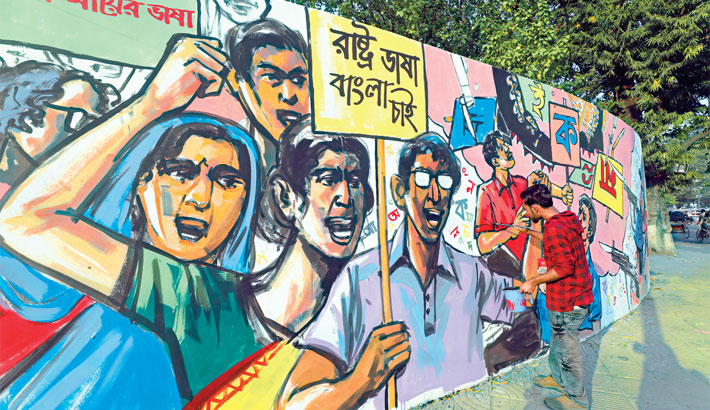 A student of the Faculty of Fine Arts of Dhaka University paints graffiti on a wall