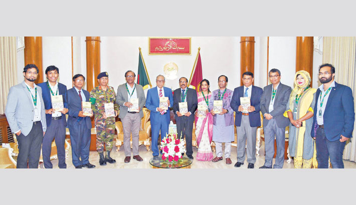 Litterateur Abul Kashem hands over a book titled 'Mourjo' authored by him