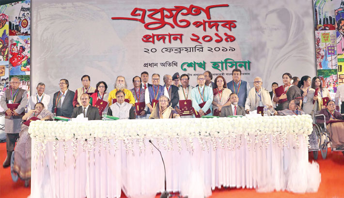 Prime Minister Sheikh Hasina poses for a photo with Ekushey Padak winners at a ceremony