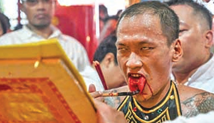 Indonesia caps Lunar New Year with bloody tongues