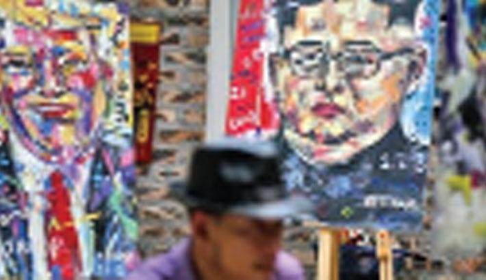 Peace portraits: Hanoi artist paints Trump, Kim for summit