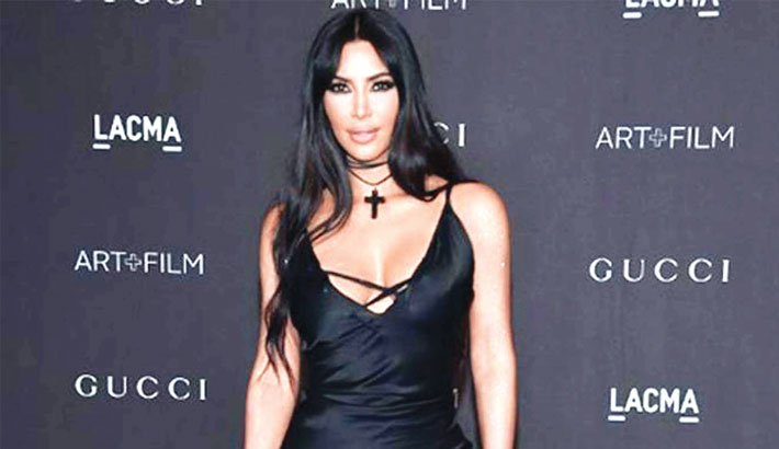 Kim sues fashion company