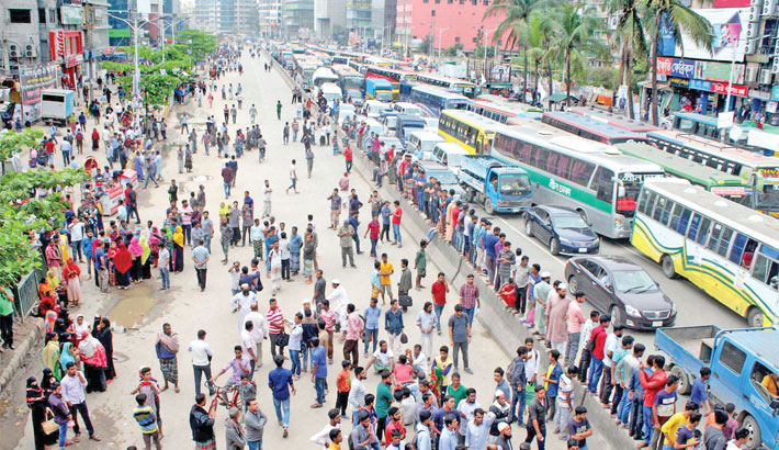 Local people in the city's Uttara area take to the street on Wednesday