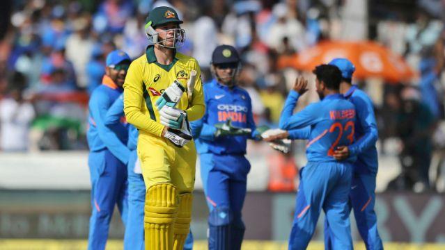 India restrict Australia to 236/7