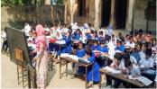 Children attend classes under open sky!