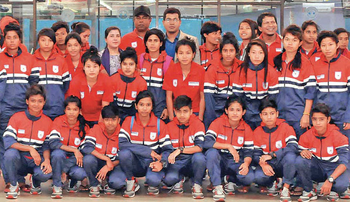 Bangladesh Under-16 Women's Football Team players pose along with officials after landing
