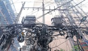 The jungle of overhead cables adds an extra weight to electric poles carrying high-voltage transformers